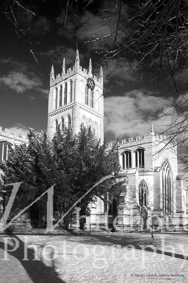 Black and white photo of St Mary's Church, Melton Mowbray, in the snow