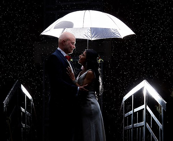 beautiful rain wedding outdoor bridge umbrella bride groom husband wife natural photography